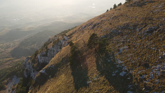 approaching hill top from aerial view - slovenia stock videos & royalty-free footage