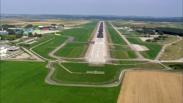 approaching memmingen airport runway  - aerial view - bavaria,  swabia,  landkreis unterallgäu,  germany - airfield stock videos & royalty-free footage