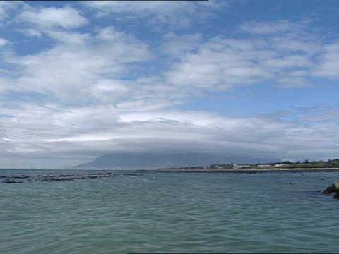 Approaching Robben Island by boat Nelson Mandela visits his old prison cell on Robben Island Nelson Mandela was imprisoned on Robben Island for18...