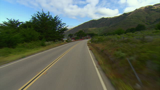pov approaching settlement of ragged point on highway u.s. 1, gorda, california, usa - ragged point stock videos and b-roll footage