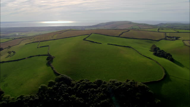 approaching the coast at croyde  - aerial view - england, devon, north devon district, united kingdom - devon stock videos & royalty-free footage