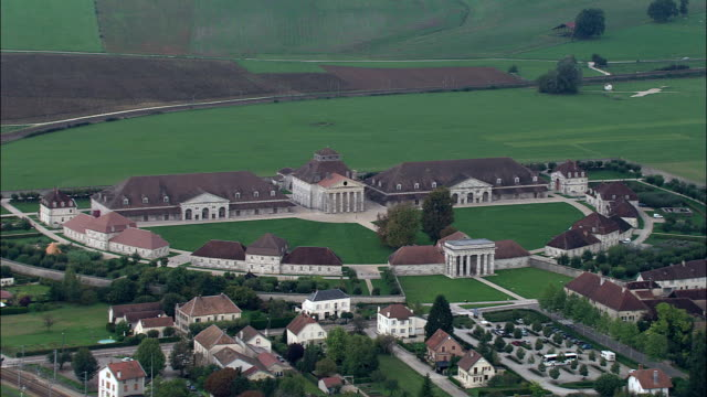 approaching the royal saltworks  - aerial view - franche-comté, doubs, arrondissement de besançon, france - royalty stock videos and b-roll footage