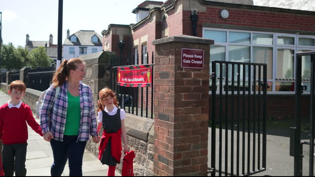 approaching the school gates - uniform stock videos & royalty-free footage