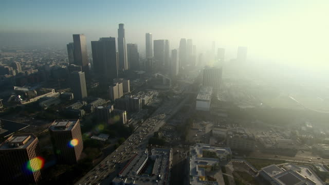 approaching the skyscrapers of downtown los angeles' financial district. - smog stock-videos und b-roll-filmmaterial