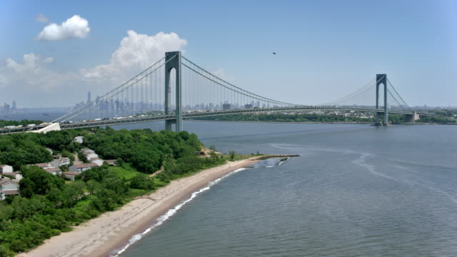 aerial approaching the verrazano-narrows bridge on a sunny day - staten island stock videos and b-roll footage