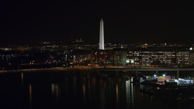 approaching washington monument over cityscape at night. shot in 2011. - artbeats stock videos & royalty-free footage