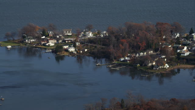 approaching waterfront residential area east of baltimore, maryland. shot in november 2011. - artbeats video stock e b–roll