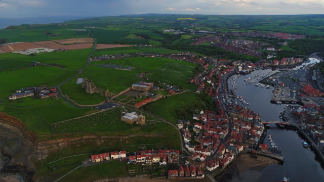 approaching whitby abbey aerial video - whitby north yorkshire england stock videos & royalty-free footage
