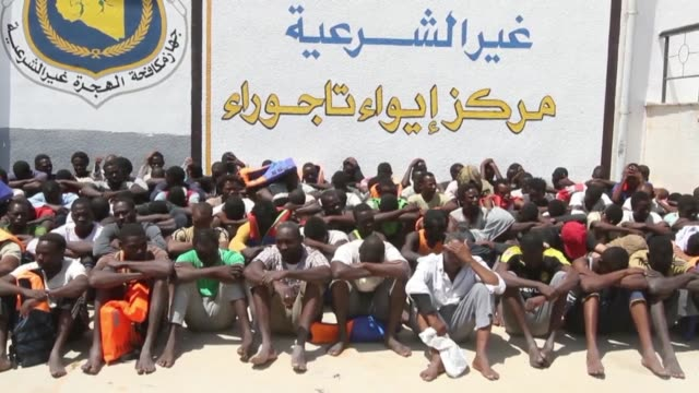 approximately 137 illegal migrants are rescued by libyan coastguards at sea and taken to a migration detention and shelter facility in the capital... - libya stock videos and b-roll footage