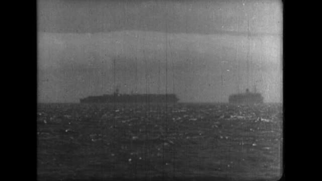 approximately 60 vessels including battleships and aircraft carriers of the us 3rd fleet temporarily anchor off the coast of zushi at the end of... - battleship stock videos & royalty-free footage