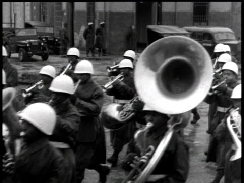 april 01 1944 ws marching band performing and moving down street / korea - marching band stock videos & royalty-free footage