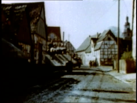april 05 1945 montage tanks driving slowly through village and a flock of geese waddling up street / germany - waddling stock videos and b-roll footage