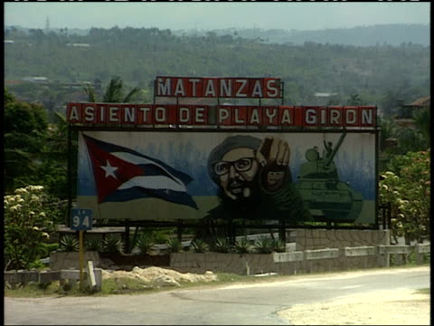 "april 1, 1994 large rural roadside billboard displaying images of fidel castro, the national flag and a military tank, with ""matanzas asiento de... - male likeness stock videos & royalty-free footage"