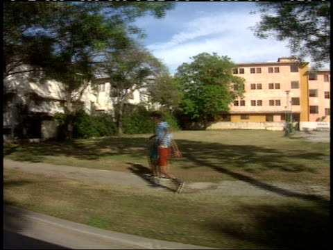 April 1 1994 SIDE POV Passing by homes and apartments in residential neighborhood / Cuba