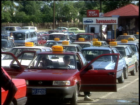 april 1 1994 ws taxi cabs wait to pick up passengers from airport / havana cuba - cuba stock videos & royalty-free footage
