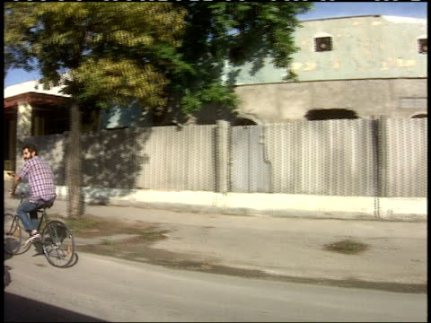 April 1 1994 TS Two bicycle riders pedaling down residential neighborhood street / Cuba