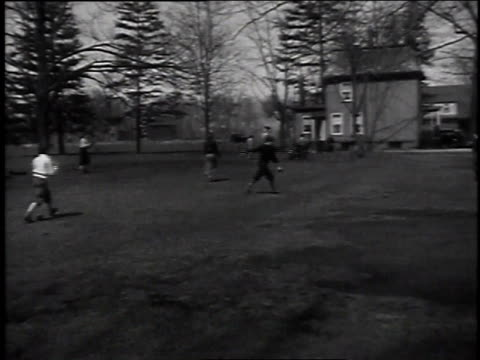 April 10, 1935 MONTAGE Boys playing baseball in yard / Englewood, New Jersey, United States