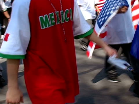 april 10, 2006 medium shot zoom in demonstrator wearing mexico t-shirt and rosary beads and cross at the immigration rights march to the national... - one teenage boy only stock videos & royalty-free footage