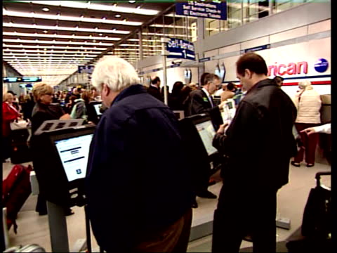 april 10 2008 pan american airlines sign hanging at airport checkin as passengers check their luggage / chicago illinois united states - 搭乗者点の映像素材/bロール