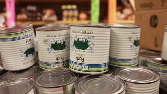 april 13, 2020 - ellettsville, indiana usa: canned pork meat at pantry 279 to help those experiencing food insecurity during the covid-19/coronavirus... - canned food stock videos & royalty-free footage