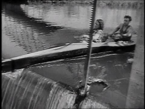 vídeos y material grabado en eventos de stock de april 15, 1946 montage kayaks and canoes going over small waterfall / paris, france - 1946
