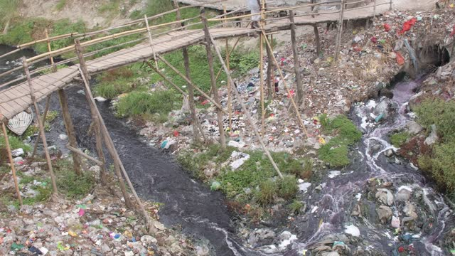 april 15 : waste water containing fabric dye is released into streams and rivers by textile industries in savar on the outskirts of the capital dhaka... - clothing stock videos & royalty-free footage