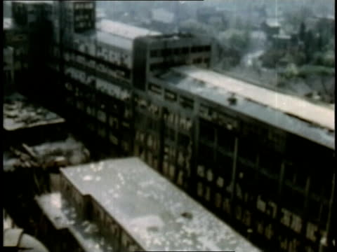 april 16 1945 ws camera sweeping over destroyed factory and town / weimar thuringia germany - campo di concentramento di buchenwald video stock e b–roll
