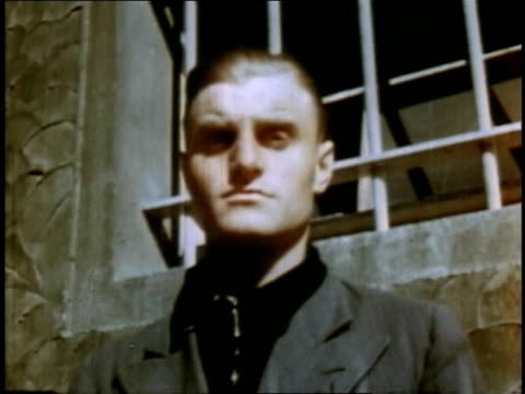 april 16 1945 cu man standing in front of window at buchenwald concentration camp / weimar thuringia germany - campo di concentramento di buchenwald video stock e b–roll