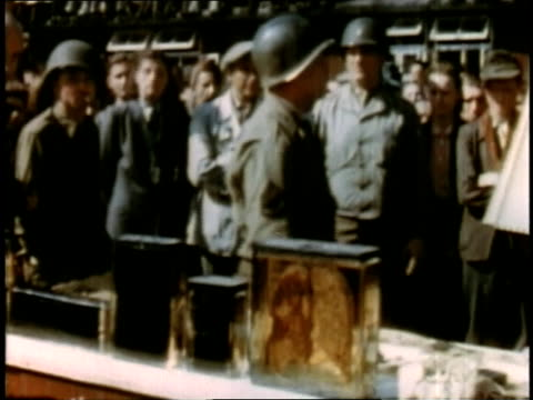 april 16 1945 montage german civilians looking at remains on table at buchenwald / weimar thuringia germany - campo di concentramento di buchenwald video stock e b–roll