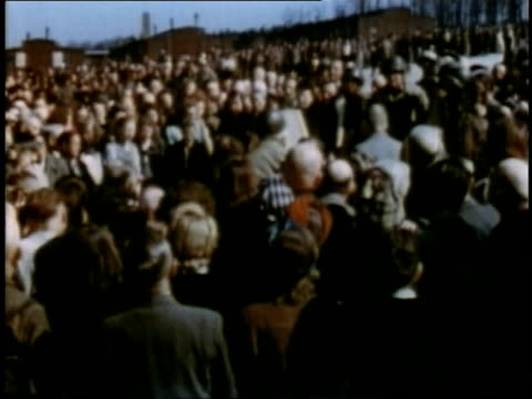 april 16 1945 montage german civilians milling around at buchenwald / weimar thuringia germany - campo di concentramento di buchenwald video stock e b–roll