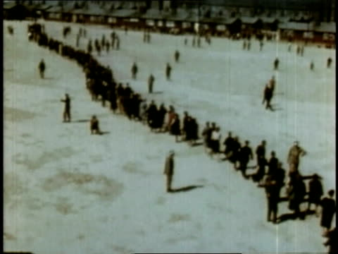 april 16 1945 montage lines of people moving through buchenwald / weimar thuringia germany - campo di concentramento di buchenwald video stock e b–roll