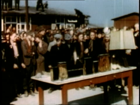 april 16 1945 montage locals viewing lampshade and other remains at buchenwald / weimar thuringia germany - campo di concentramento di buchenwald video stock e b–roll