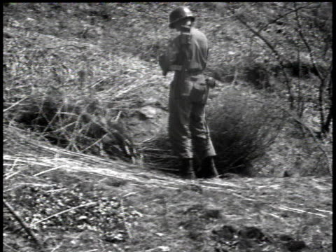 april 17, 1951 soldier detonating explosives / korea - 1951点の映像素材/bロール