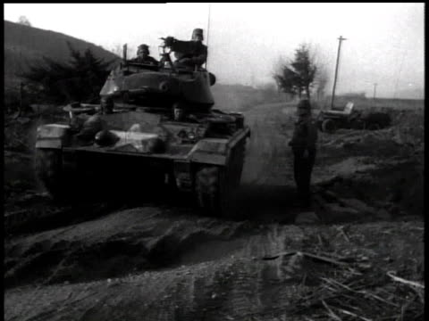 april 17, 1951 tank moving down a dusty road / korea - 1951点の映像素材/bロール