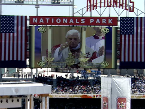 april 17 2008 montage crowd watching pope benedict xvi on the scoreboard screen at nationals park / washington dc united states - 2008 stock videos & royalty-free footage