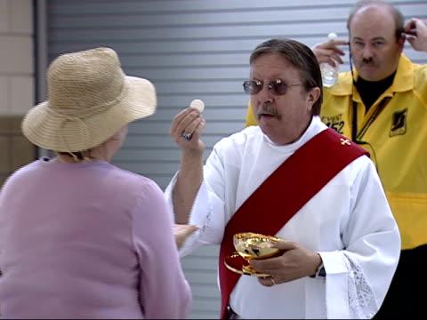 april 17, 2008 montage priest performing communion / washington, d.c., united states - ナショナルズパーク点の映像素材/bロール