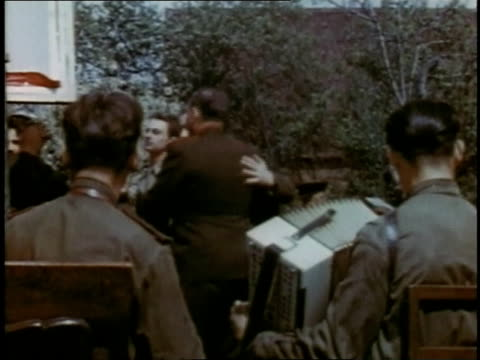 april 19, 1945 couples dancing to accordion music / torgau, saxony, germany - nazism stock videos & royalty-free footage