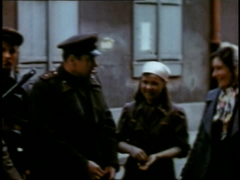 april 19, 1945 montage women chatting with officers on street / torgau, saxony, germany - raw footage stock videos & royalty-free footage