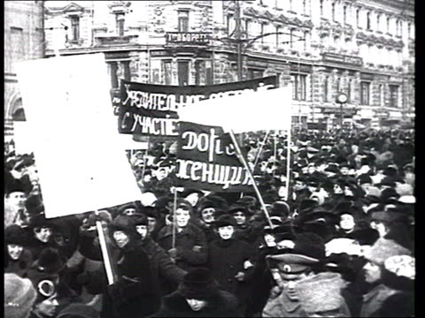 April 1917 Huge demonstrations in St Petersburg and Moscow crowded streets banners asking for dividing up the land praising the Russian army and...