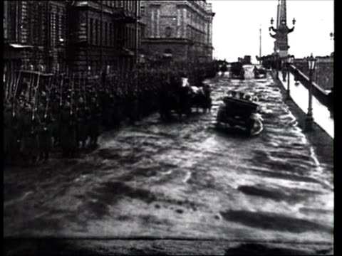april 1917 montage b/w revolutionary troops marching followed by demonstrators in st. petersburg's streets after the february revolution/ st. petersburg, russia - cyrillic script stock videos & royalty-free footage