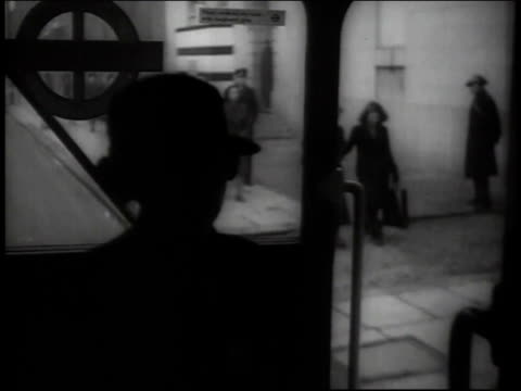april, 1941 ms interior scene of conductress looking out from moving bus / united kingdom - transport conductor stock videos & royalty-free footage
