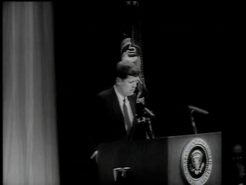 vídeos de stock e filmes b-roll de april 1961 montage john f kennedy speaking from podium about soviets orbiting man in space / washington dc united states - 1961