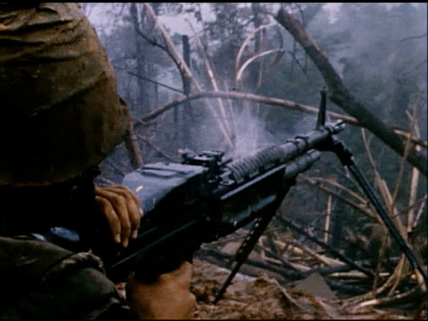 april 1967 montage soldiers fire an overheating m60 machine gun and cool the barrel with their canteens / south vietnam - machine gun stock videos & royalty-free footage