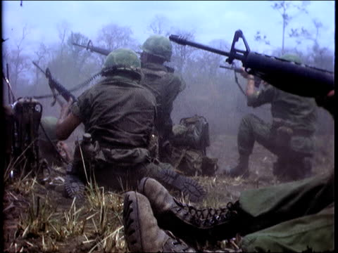 april 1967 montage soldiers in small arms firefight / south vietnam - guerra del vietnam video stock e b–roll