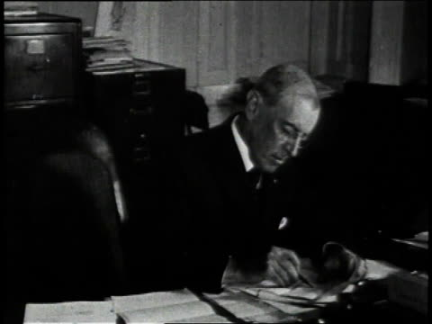 stockvideo's en b-roll-footage met april 2 1917 ms president woodrow wilson writing at a desk / united states - woodrow wilson