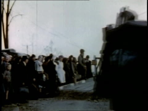 april 20, 1945 people waiting on side of road at bridge as military vehicles drive by / torgau, saxony, germany - saxony stock videos & royalty-free footage