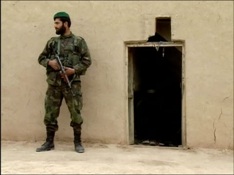 april 2004 armed afghan national army soldier standing guard at entrance to bunker / kandahar province afghanistan - afghan national army stock videos & royalty-free footage