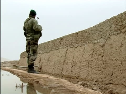 april 2004 armed afghan national army soldier standing guard at wall / kandahar province, afghanistan - afghan national army stock videos & royalty-free footage