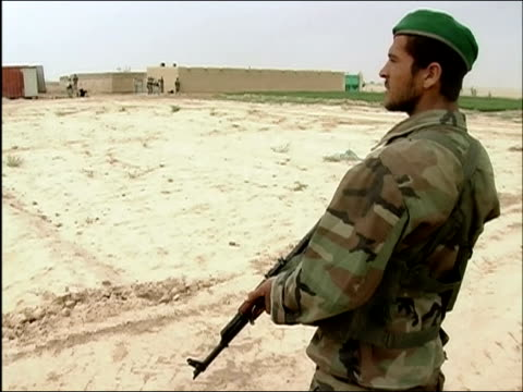April 2004 armed Afghan National Army soldier standing guard outside bunker / Kandahar Province Afghanistan