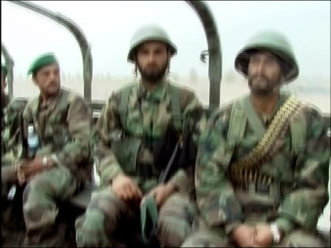 vídeos de stock e filmes b-roll de april 2004 / armed afghan national army soldiers riding in back of open truck outside kandahar afghanistan - exército nacional afegão